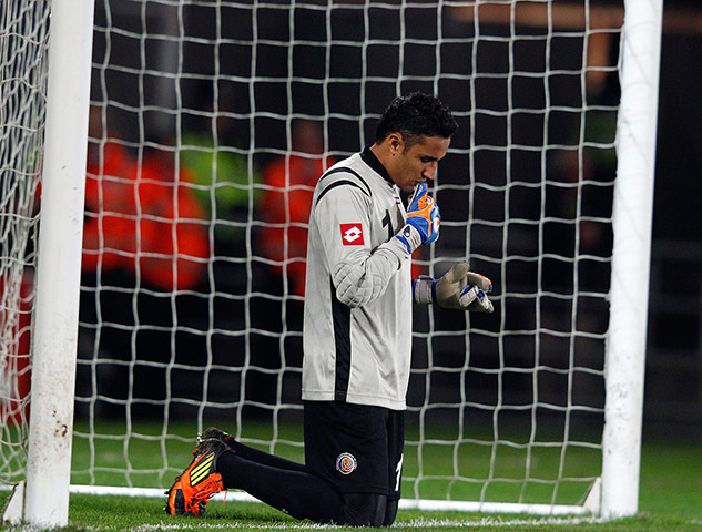 Costa Rica's Keylor Navas prays before the second half